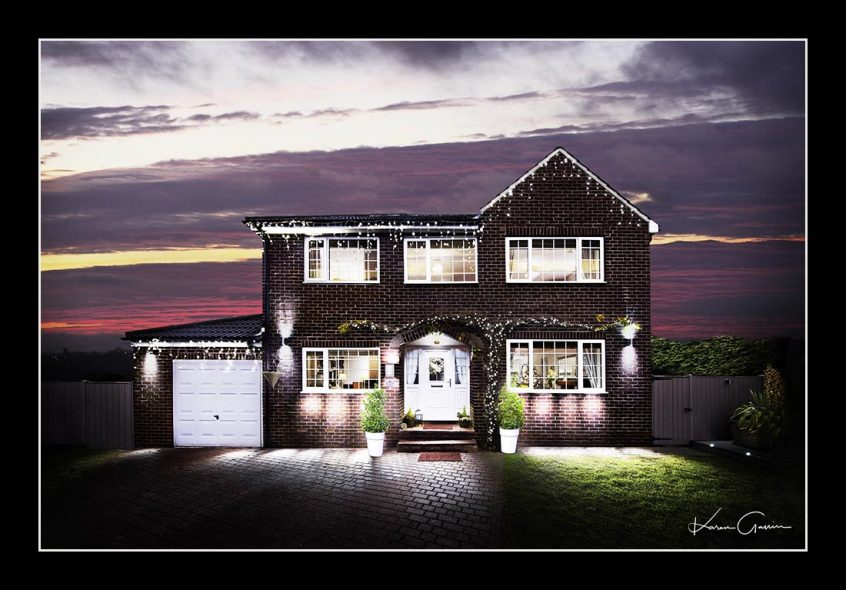 Unique fine art photo of large house using a distinctive lighting technique
